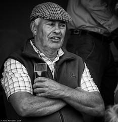 A flat cap and a pint of scrumpy. (Neil. Moralee) Tags: middevonshow2018neilmoralee neilmoralee man cap cider pint scrumpy face portrait farmer drink drinker hat tradition devon shirt teeth old mature farming apples jack arms folded county country gent neil moralee nikon d7200 candid