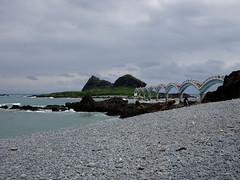 Sanxiantai bridge (Claire Backhouse) Tags: taiwan sanxiantai bridge coast ocean island water sky beach pebbles clouds
