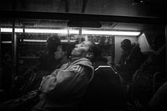 Tough day. (markfly1) Tags: woman asleep sleeping relaxing 40 winks cat nap bus journey travel transport baw black white mono monochromatic candid photography street image passenger seated seats chairs resting nikon d70 35mm manual focus lens