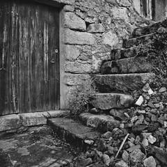 At Unhais da Serra (lebre.jaime) Tags: portugal estrela highland mountain mountainrange unhais bw noiretblanc blackwhite pretobranco pb unhaisdaserra ptbw kodak hasselblad 503cx distagon 3560 mediumformat film 120 portra160 portra160120 portra rustic house door window stairs wall stone