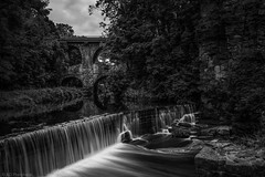 Over the Goyt (Anthony P.26) Tags: architecture category derbyshire england newmills places waterfall bridge viaduct tree sky water river goyt rivergoyt travel travelphotography roadbridge stone gorge greysky waterfalls silkywater longexposure monochrome blackandwhite mono whiteandblack bw forest trees woodland rock reflections canon70d canon canon1585mm outdoor nature natural countryside rural