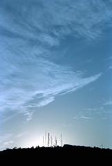 Sunset (PhantomClickr) Tags: film 35mm fuji fujifilm superia 200 canon eost2 eoskiss eos300x nature brasil brazil analog animal filmisnotdead sky ceu nuvens clouds antenna antena tv backlight sunset sun sundown