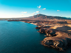 Bird eye view of Costa de Papagayo (wuestenigel) Tags: resort sand landscape cliffs water mountains city vacation rocks lanzarote beach scenery travel island aerial spain eu tourism ocean drone kanarischeinseln spanien es wasser noperson keineperson reise seashore strand sea meer landschaft ozean insel sky himmel outdoors drausen seascape seelandschaft scenic szenisch rock bay bucht nature natur summer sommer sunset sonnenuntergang mountain berg lake see