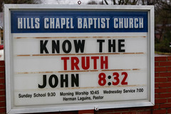 The Hills Chapel Baptist Church in Greensboro, Georgia, sports a marquee sign with a bible verse. A'Nasia Monford and her family are members of the Hills Chapel community.