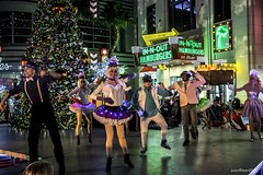 Pop Up Christmas (evanffitzer) Tags: vegas lasvegas fujix100s fujifilmx100s musical entertainment colour dance christmas tree streetphotography happy performance stage sing costumes broadway thelinq perform surprise
