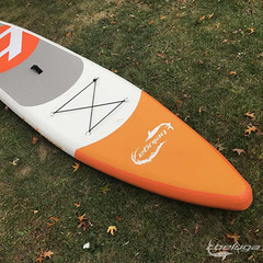 Orange SUP (belugaboats) Tags: sup inflatablesup touring touringboard standuppaddleboarding isup watersport sleepingbearpointbeach