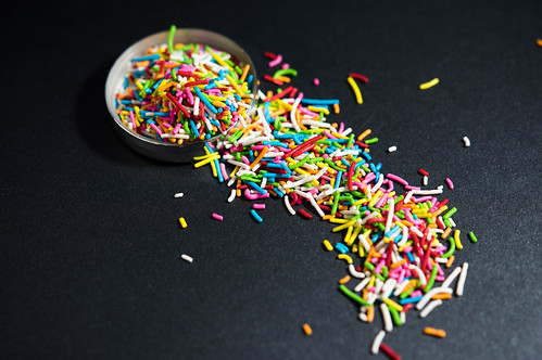 Rainbow sprinkles on a small container