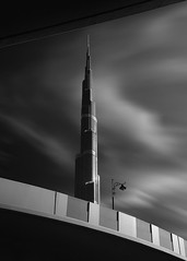 Exposed (Radisa Zivkovic) Tags: architecture dubai skyscraper building blackandwhite longexposure artistic burjkhalifa lamp cloud motion blurred street light skyline tower city travel uae town futuristic famous landmark vacation destination tall high fineart sunlight sky modern upward wind curve