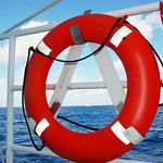 A flotation device is secured to the railing of Freedom Star, one of NASA's solid rocket booster retrieval ships. Original from NASA . Digitally enhanced by rawpixel. thumbnail