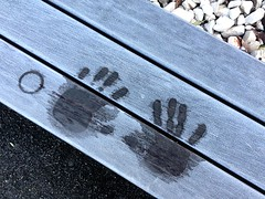 Warm Hands, Cool Hands (Dan Daniels) Tags: hands handprint iphone4s audand bench kantonbaselstadt switzerland suisse schweiz svizerra wood rocks patterns angles frost winter riehenbsschweiz