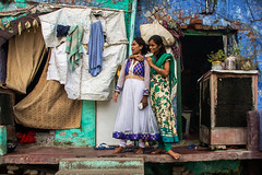 Conversation.  Lucknow. Uttar Pradesh. India. (Tito Dalmau) Tags: portrait double conversation women house blue green lucknow uttar pradesh india
