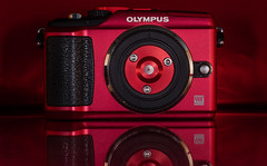 Olympus. (CWhatPhotos) Tags: cwhatphotos camera photographs photograph pics pictures pic picture image images foto fotos photography artistic that have which contain digital black micro four thirds olympus macro closeup 43 rds 43rds light shadow art round circle circular graphic logo vision approach view red pen lit bodycap body cap epl2 cameras reds rouge rojo rot 赤 holga pin hole flickr