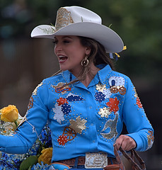 Horse Rider (Scott 97006) Tags: woman rider equestrian parade smile wave hat outfit pretty beauty miss rodeo cowgirl earring flower