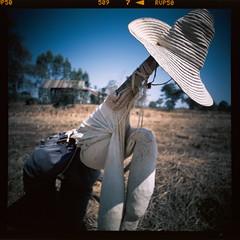 sitting scarecrow (Matt Jones (Krasang)) Tags: lomolca120 fuji velvia 50 slide film e6 scarecrow field