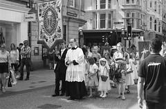 Parade (Jim Davies) Tags: film analogue analog veebotique 35mm konica vx400 expired blackandwhitefilm monochrome chromogenic c41 bw streetphotography street oxford cornmarket parade religion christianity