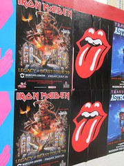 Iron Maiden with Rolling Stones Lips and Tongue Posters 5253 (Brechtbug) Tags: iron maiden concert poster blue construction fence eddie devil monster zombie album british heavy metal skeletal sidekick west 45th street nyc 2018 november 11182018 brit soldier creepy demon dude union jack flag torn billboard posters billboards cover art