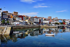 Fisterre Harbour (Jocelyn777) Tags: sea seascapes cityscapes landscapes harbour boats water blue sky reflections waterreflections villages towns cityviews fisterre costadamorte galicia spain travel