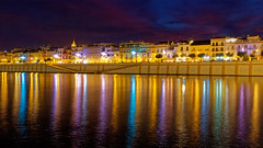Friday night at Triana (HansPermana) Tags: sevilla seville spain spanien españa iberianpeninsula andalusia alandalus eu europe europa südeuropa southerneurope lights longexposure guadalquivir river water reflection triana architecture canaldealfonsoxiii november 2018 herbst autumn bluehour