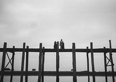 People Crossing U Bein Bridge In Amarapura, Mandalay, Myanmar (Eric Lafforgue) Tags: amarapura ancient architecture asia asian blackandwhite bridge burma copyspace culture day grainy historical horizontal landmark landscape lowangleview mandalay monument myanmar nature old outdoors photography row rural scene silhouette structure teak teck threepeople tourism traditional travel traveldestinations trix ubein water wood leicaburma386 mandalayregion