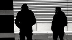 Waiting for the train.... (markwilkins64) Tags: london waterlooeast railwaystation station streetphotography street candid mono monochrome blackandwhite bw markwilkins mark silhouette silhouettes mobilephone uk