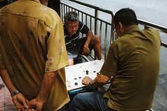 Tactics (D. R. Hill Photography) Tags: bangkok thailand thai asia southeastasia makruk thaichess chess game tactics competition boardgame urban city street streetphotography chinatown candid men people watching film analog analogue grain 135 35mmfilm contax contaxg2 carlzeissplanar35mmf2 zeiss planar 35mm primelens fixedfocallength kodak kodakfilm kodakportra400 portra portra400
