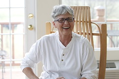 Martha Coleman, from Greensboro, Georgia, sits in a rocking chair in her sun room. Coleman recounts stories of her family and about her new life on the farm after leaving work at her beauty shop in Greene County.