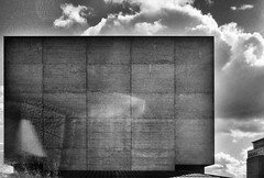(Delay Tactics) Tags: london national theatre brutal brutalist brutalism brutiful concrete sky angles red october oktober architecture geometric lines building window wall film black white blackandwhite bw lens flare