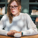 Blond woman having a cup of coffee thumbnail