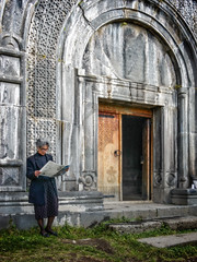 Reading the TV guide (Tigra K) Tags: haghpat loriprovince armenia am 2011 architecture carving church door medieval mural ornament person portal wood art arch pattern