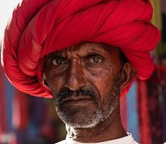 Intriguing eyes. (F Image Gallery) Tags: sonyalpha red india nostalgia people eyes turban streetphotography travelphotography travel fabiolavelasquez portraitphotography portrait man happyplanet asiafavorites