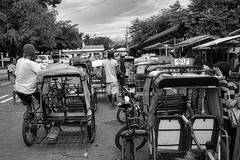 Pedicabs (Beegee49) Tags: street public transport waiting pedicab parked cyclists people sony a99 blackandwhite monochrome bw luminar happy planet silay city philippines asia