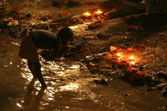 Blessings for a new ending (daniel virella) Tags: sunset rituals ganges ganga गंगा varanasi वाराणसी uttarpradesh उत्तरप्रदेश india भारत bharat child river lamps flowers religion picmonkey desi hinduism