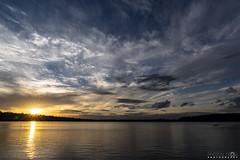 Last Peek of Sun (BobbyFerkovich) Tags: bristolsunsetrentonwashingtonlakewashington clouds water sun twilight dusk