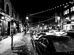 Rue Saint-Laurent by Night (MassiveKontent) Tags: noiretblanc blackwhite montreal bw city monochrome urban blackandwhite streetphoto montréal quebec street photography bwphotography streetshot night nightshot shadows blancoynegro metropolis cityscape cityatnight streetlight road people car building