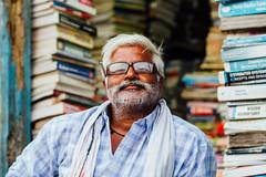 Bookshow Owner, Varanasi India (AdamCohn) Tags: adamcohn allahabad india uttarpradesh varanasi books glasses man shopkeeper streetphotographer streetphotography wwwadamcohncom
