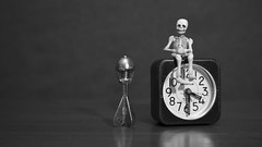 untitled (N.the.Kudzu) Tags: tabletop stilllife diecast capbomb clock miniature skeleton bw canoneosm 7artisans35mmf12 canondigitalphotopro4