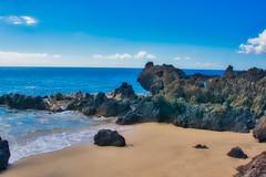 Tiny Sand (Kirt Edblom) Tags: maui mauihawaii hawaii gaylene wife water waves waterscape milf landscape scenic sand beach blue bluesky bluewater rocks lava lavaflows pacific pacificocean ocean coast serene seascape kirt kirtedblom edblom luminar nikon nikond7100 nikkor18140mmf3556