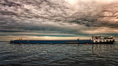 Speed Delivery (Alfred Grupstra) Tags: sea sunset cloudsky nauticalvessel water transportation sky dusk cloudscape harbor shipping travel nature outdoors freighttransportation pier modeoftransport commercialdock ship industrialship macromondays safety