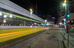 Zoom Zoom! (tquist24) Tags: dallas nikon nikond5300 pacificavenue texas city cityscape downtown geotagged lights longexposure night sky skyscrapers starburst street streetcar trafficlight train urban