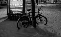 IMG_5834-18 (Goldenwaters) Tags: streetphotography lensculture subjective capturestreets canon50d 50d vienna wien citystreets winter snow snowing white winterweather europe bic bicycle lonely