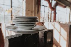 Spider web on plates (Explored) (rantropolis) Tags: abandonedfactory pottery china factory abandoned urbex ur urbanexploration nikon d750 50mm plates spiderweb autumn hue