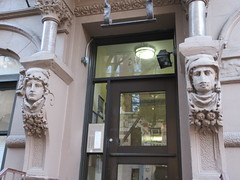 Woman with High Collar Gargoyle Next to Door Way 4683 (Brechtbug) Tags: woman with high collar gargoyle above door front exterior building entrance new york city near 9th ave west 21st street nyc 2018 gargoyles statue sculpture man portrait art downtown stone terracotta tile artist portraits 20s area w women slope low nose