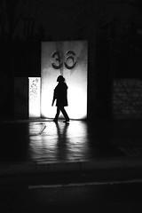 Returning at 36 (pascalcolin1) Tags: paris13 femme woman nuit night pluie rain reflets reflection lumière light nombre number porte door photoderue streetview urbanarte noiretblanc blackandwhite photopascalcolin 50mm canon50mm canon