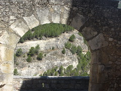 Lookout over the Jucar Gorge, through an arch in the city walls, Cuenca. (d.kevan) Tags: jucargorge valleys rocks views rockformations cliffs plants trees cuenca grass arches lookouts walls