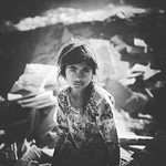 Iqra a daughter from the slums area. A beautiful girl with dusty face and dusty hair was sitting on a huge dump of garbage and remains of bricks. thumbnail