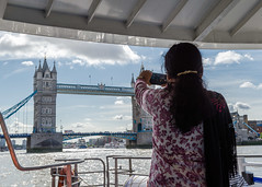 Thames Clippers (24hrLDN) (Spannarama) Tags: thames river london uk 24hrldn thamesclippers ferry boat blueskies clouds photo camera takingaphoto tourist towerbridge bridge woman
