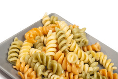 Served cooked colorful macaroni on the plate (wuestenigel) Tags: close boiled restaurant mediterranean table eat background dinner red carbohydrate pasta noodle cooked isolated yellow traditional closeup cooking meal italy nutrition white macaroni healthy plate gourmet food whitebackground colorful italian ingredient lunch cuisine tasty freshness vegetarian green nobody dish lot detail