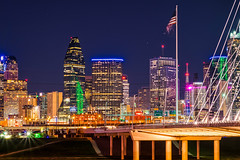 So Many Lights! (tquist24) Tags: dallas hdr margarethunthillbridge nikon nikond5300 texas architecture bridge city cityscape downtown flag flagpole geotagged lights longexposure night sky skyline skyscraper skyscrapers starburst urban unitedstates