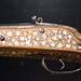 Mother-of-pearl marquetry on antique firearm