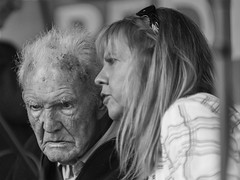 A word in your ear - a jig or a reel? (Frank Fullard) Tags: frankfullard fullard candid street portrait lady gentleman ballinasloe fair horsefair musician talk listen word ear advice monochrome black white blanc noir galway irish ireland blonde elderly older